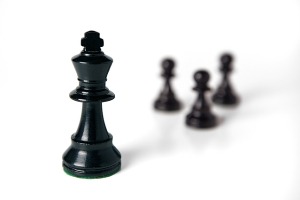 Black Chess King with Pawns